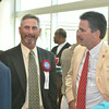 Randy Mazey (left), a 2014 Cambria County Sports Hall of Fame inductee, and Bishop McCort hockey coach John Bradley chat with attendees.