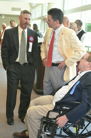 Randy Mazey (left), a 2014 Cambria County Sports Hall of Fame inductee, Bishop McCort hockey coach John Bradley (center) and former Crusher hockey coach Galen Head chat before the ceremony.