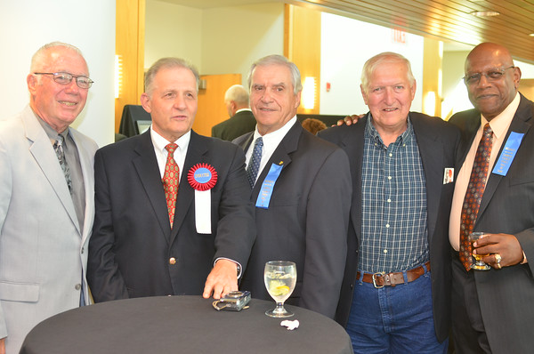 (From left): George Azar, John Kasay, Ed Adamchik, Gene Buchan and Jeff Richardson, all members of the Johnstown High Trojan football squad from different years, pose at the 2014 Cambria County Sports Hall of Fame banquet.