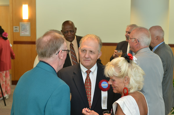 Cambria County Sports Hall of Fame 2014 inductee John Kasay (center) speaks with banquet attendees.