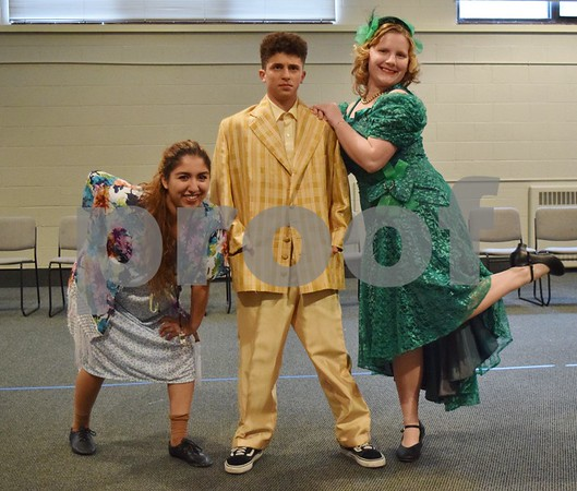 "Children's Community Theatre will present the musical ""Annie Jr."" this weekend at the Egyptian Theatre in DeKalb. Pictured (from left) performing the song ""Easy Street"" are 18-year-old Kinsley Judd of Genoa as Miss Hannigan, 14-year-old Charlie Vivirito of DeKalb as Rooster Hannigan and 13-year-old Kendel Graham of Somonauk as Lily St. Regis."