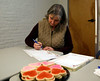 HOLLY PELCZYNSKI - BENNINGTON BANNER Jeannie Jenkins, of Bennington writes letters to Veterans during a More Love Letters letter-writing party held at CCV.