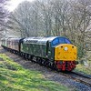 The 10.00 Heywood - Rawtenstall train with EE Type 4 40106 in charge rumbles past Summerseat Crossing on the East Lancashire Railway. 9th April 2017