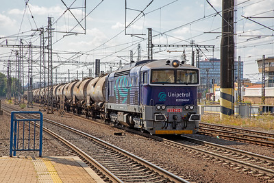 Unipetrol 'Goggles' 753 741-8  leaving Praha Liben yard on a train of tank wagons on 10th July 2019.