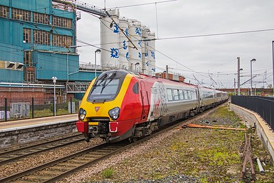 Virgin Voyager 221 103  rumbles into Warrington Bank Quay whilst forming the 10.00 Glasgow Central - London Euston (via Birmingham) on 7th April 2017.