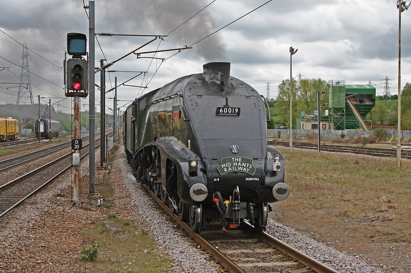 Gresley A4 60019 'Bittern' rolls into Grantham with the 'Scarborough Flyer' from Kings Cross on 29th April 2010. The headboard advertises the railway where she was restored to running order in 2007.