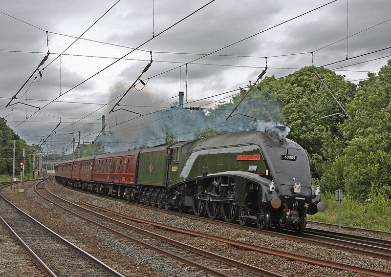 Another shot in the gloom at Lancaster, as 60009 hurries along the 'up fast' returning south with the 'Moorlander' of 23rd July 2012. The last time I'd seen a green A4 at this spot was in November 1967 (I think) when 60019 (then in preservation) charged through on an enthusiasts special.
