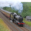 61994 gets in to her stride as she barks through Helwith Bridge on the outbound 'Fellsman' of 8th August 2012.