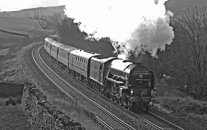 A1 Pacific 60163 'Tornado' storms past Helwith Bridge on 15th February 2017 whilst heading the 10.44 Skipton to Appleby  service.  The loco and coaches had been drafted in by  Northern Rail in a planned move to replace the normal DMU stock on this service.  Marketed as 'England's first steam hauled timetabled train since the 1960's, passengers paid only the normal public fare to ride behind this iconic locomotive!