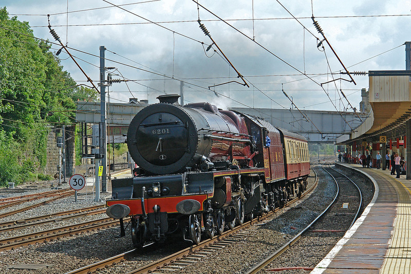 6201 drifts through Lancaster on the 'down fast' during a positioning move with her support coach on 4th July 2008.