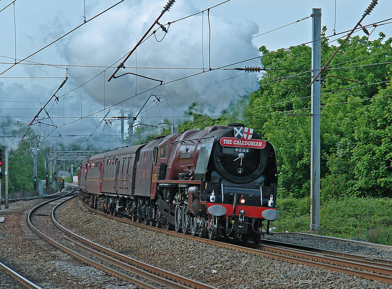 6233 leans to the curve of the 'up fast' at Lancaster with the 'The Citadel Express' of 24th May 2008.  A red 'semi' wearing the 'Caledonian' headboard brought back happy childhood memories  of watching trains from this very spot..........almost 50 years earlier!