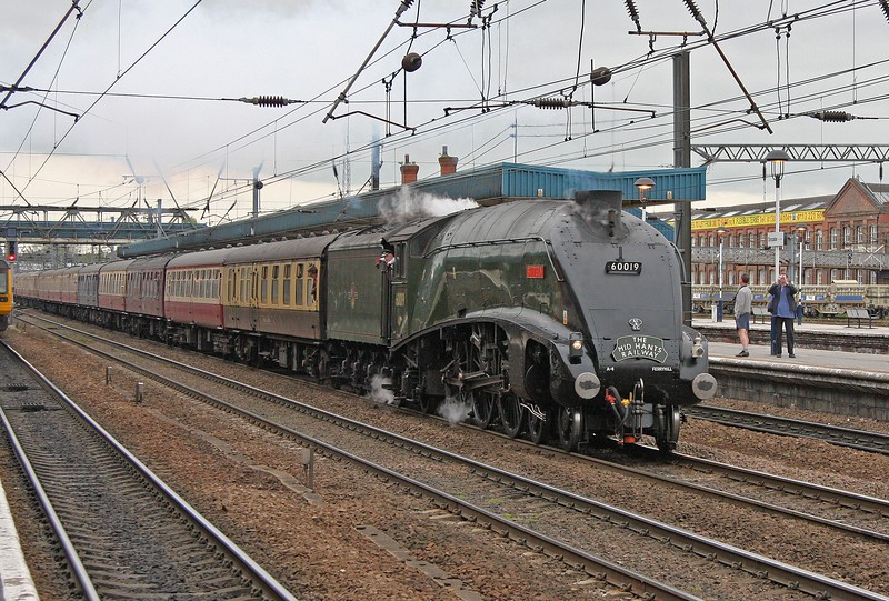 Gresley A4 60019 'Bittern' on the down fast at Doncaster with the 'Scarborough Flyer' from Kings Cross on 29th April 2010. It was good to see her on home territory and passing her birthplace in the background. The headboard advertises the railway where she was restored to running order in 2007.