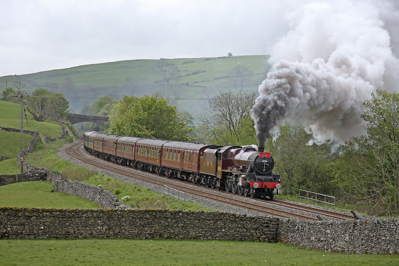 A 'Jubilee' on the 'Thames-Clyde Express.'  'Leander' digs in for the long climb north through Helwith Bridge on 17th May 2009.