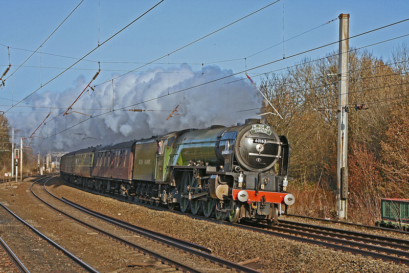 60163 roars through Lancaster at the head of the 'Christmas Coronation' tour from Edinburgh to London Euston on 20th November 2010.  This was her third consecutive day of main line running as she had come down from London to Edinburgh on the 18th and completed an Edinburgh – Carlisle circular tour the day before.  Sadly she was taken off the train at Rugby due to combustion issues, said (at the time) to be caused by inferior coal.
