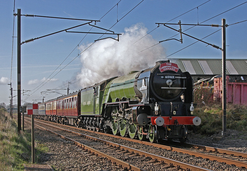 60163 'Tormado' lives up to her name as she tears along the WCML at Woodacre between Preston and Lancaster.  She was hauling the 'Cumbrian Coast Tornado' tour from Crewe – Carlisle and back;  out via the Cumbrian Coast and returning over the S and C. 14th April 2010.