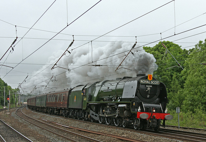 46233 tears through Lancaster at the head of the up 'Royal Scot'  on Saturday 9th June 2012. The north end of platform 3 was one of my  favourite spots to watch trains as a kid.  Although taken in very gloomy conditions ... this shot takes me back to a time of anoraks, combined volumes and a seat on the valve wheel of the water column close by!