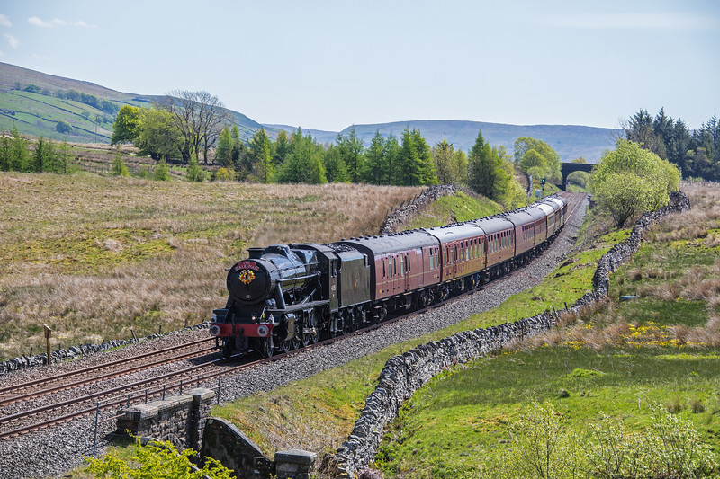 Ex LMS 8F 48151 drifts down from Ais Gill summit whilst working the northbound 'Dalesman' train on 15th May 2018.