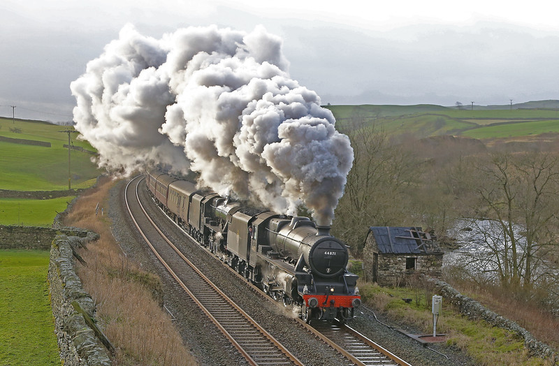 Stanier 'Black Fives' 44871 and 45407 storm through Helwith Bridge at the head of the 'Winter Cumbrian Mountain Express' on 23rd January 2016. The train was originally planned to be pulled by the newly overhauled 'Flying Scotsman.'...the Class 5's stepping in at short notice when the A3 suffered air pump problems.