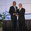 NMA President Lawrence Sanders, Jr., MD presents CDU President and CEO Dr. David M. Carlisle with the President's Award.
