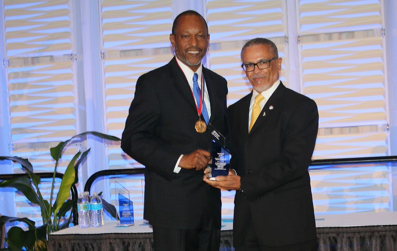 NMA President Lawrence Sanders, Jr., MD present CDU President Dr. Carlisle with the NMA President's Award.