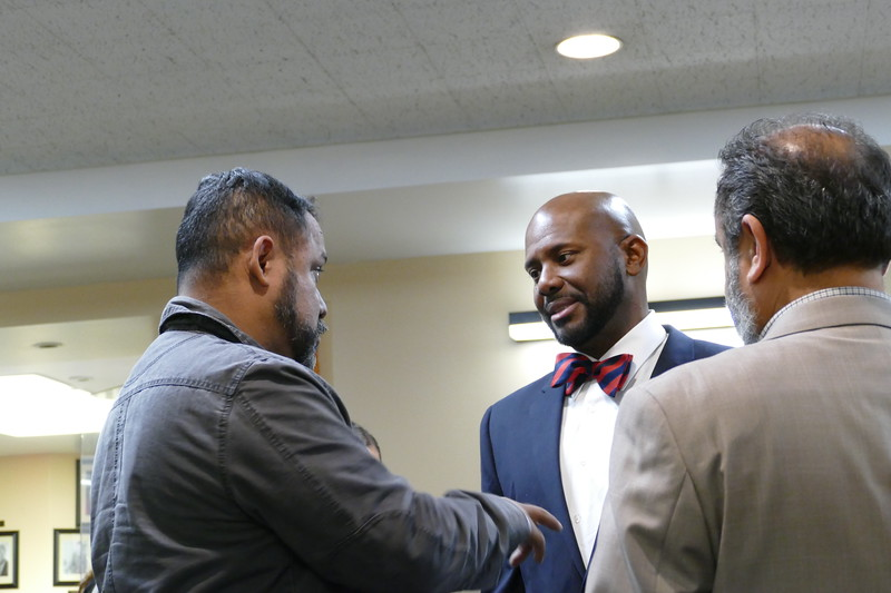 Assemblymember Mike Gipson chats with constituents