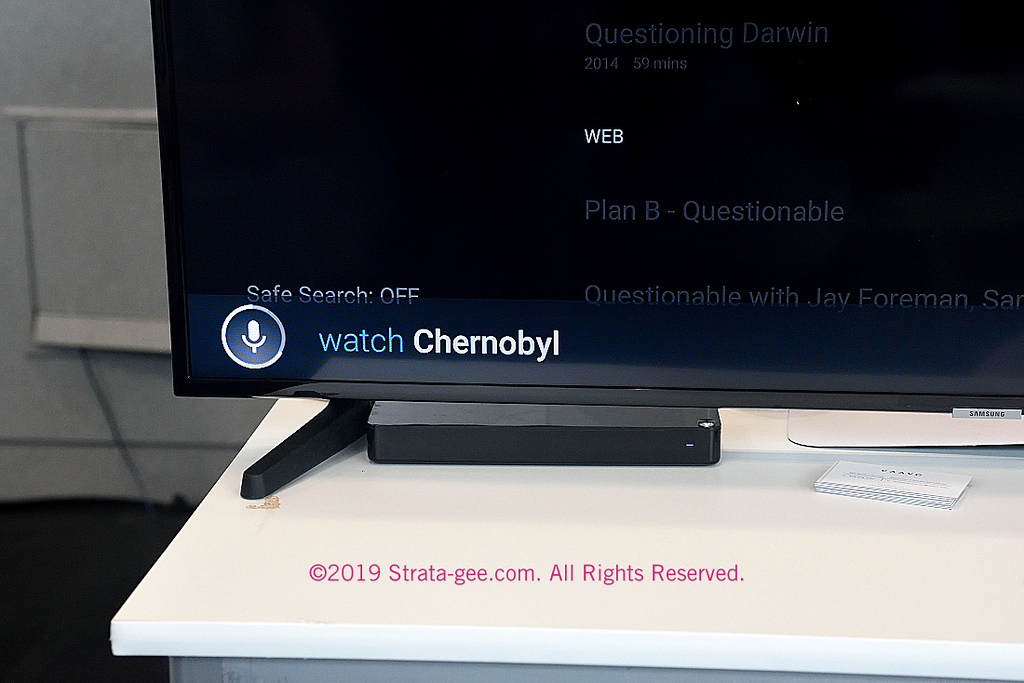 "A photo showing how voice commands show up on the screen...in this case, ""Watch Chernobyl"""
