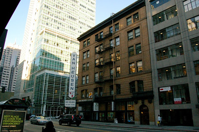Old Building  An old building, just like you see on TV.  I like how this old looking building is stuck between two modern buildings.