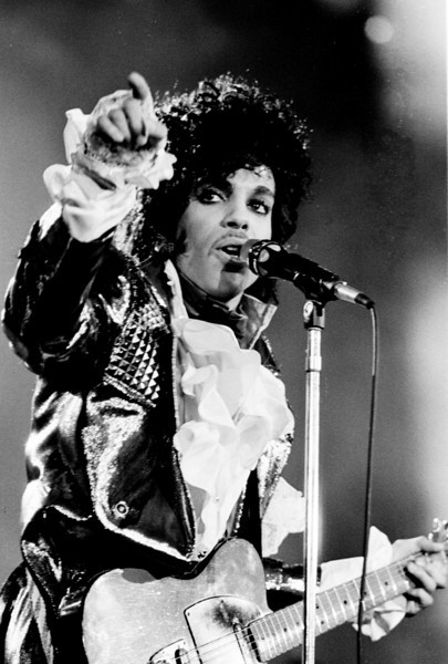 Prince performing concert.