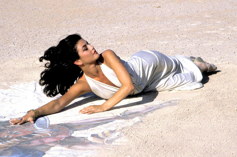 """Catherine Zeta Jones performing the song """"For All Time"""" during the taping of her video in a dry bed lake at China Lake, California"""