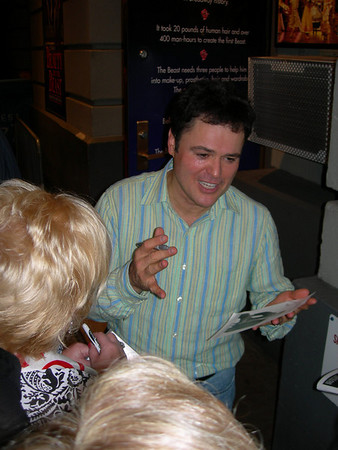 Donny Osmond signs for fans after his debut on Broadway in Beauty and the Beast.