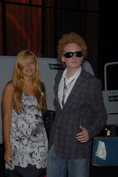 "Art Garfunkel's son James Garfunkel arrives for the Gwen Stefani ""LAMB"" fashion show with his girlfriend on September 6, 2007 (Photo Credit: HughE Dillon)"