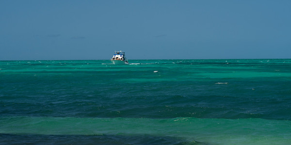 Sea with boat in the background, Half Moon Caye, Lighthouse Reef Atoll, Belize