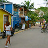 Woman walking on street, West End Village, Roatan, Honduras