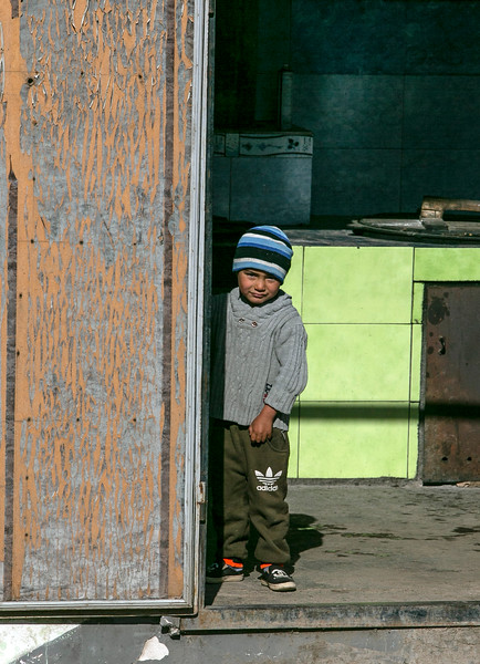 Host's grandson at cookhouse door