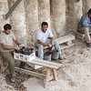 Workers at archaeological dig near Temple walls
