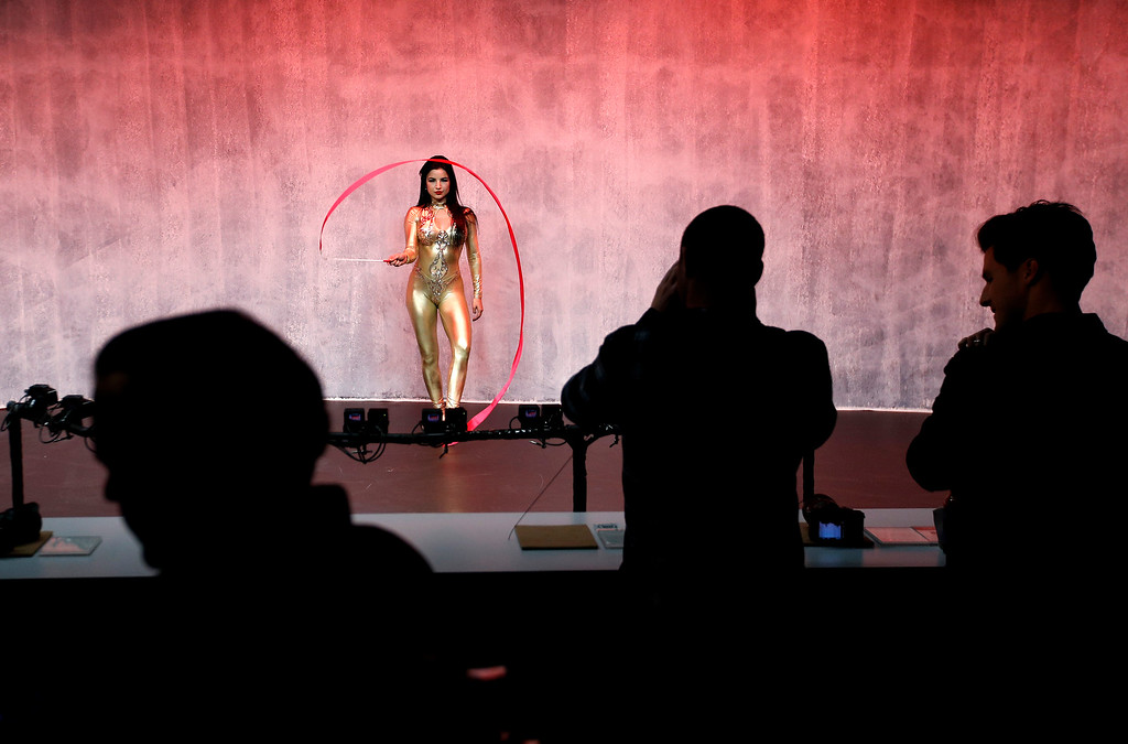. A model performs at a display for Sony cameras after a Sony news conference at CES International, Monday, Jan. 8, 2018, in Las Vegas. (AP Photo/John Locher)