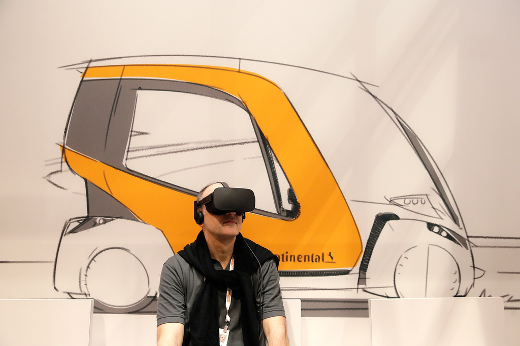 . An attendee watches a presentation using a VR headset at the Continental booth at CES International, Tuesday, Jan. 9, 2018, in Las Vegas. (AP Photo/Jae C. Hong)