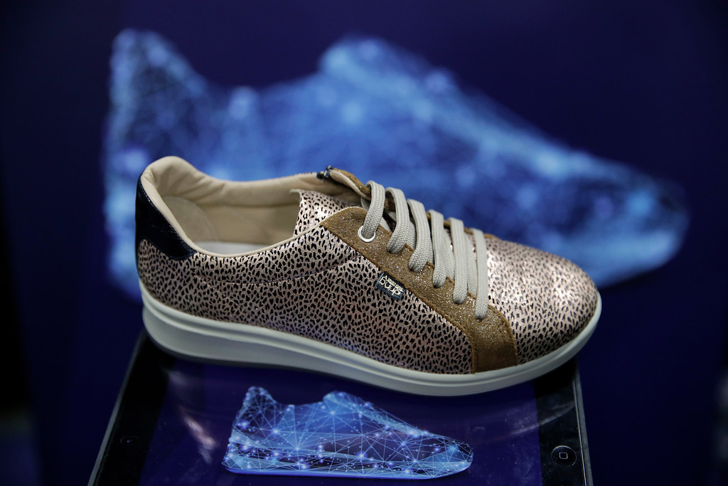. The E-Vone smart shoe is displayed during CES Unveiled at CES International Sunday, Jan. 7, 2018, in Las Vegas. The shoes are equipped with an electronic device that will send an alert to medical services or family if the person wearing them happens to fall. (AP Photo/Jae C. Hong)