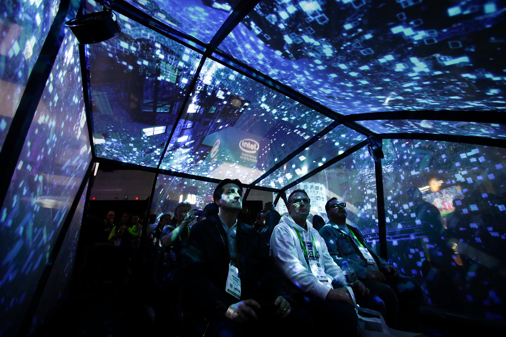 . Attendees sit in an autonomous driving experience tent at the Intel booth at CES International, Tuesday, Jan. 9, 2018, in Las Vegas. (AP Photo/Jae C. Hong)