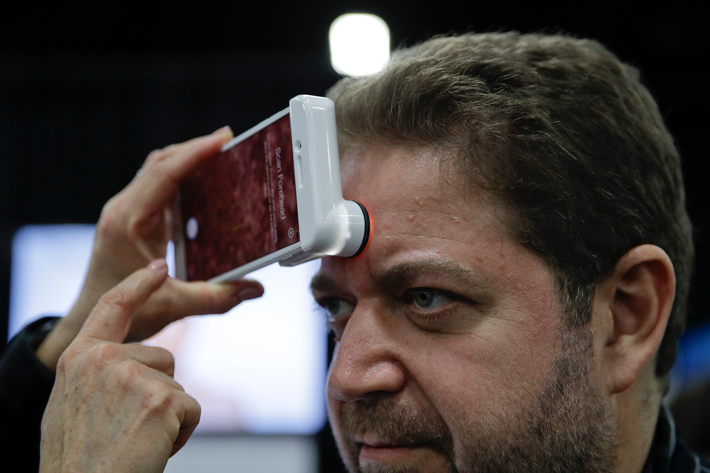 . Gabriel Pleszowski gets his skin analyzed using Neutrogena\'s Skin360 and SkinScanner during CES Unveiled at CES International Sunday, Jan. 7, 2018, in Las Vegas. (AP Photo/Jae C. Hong)