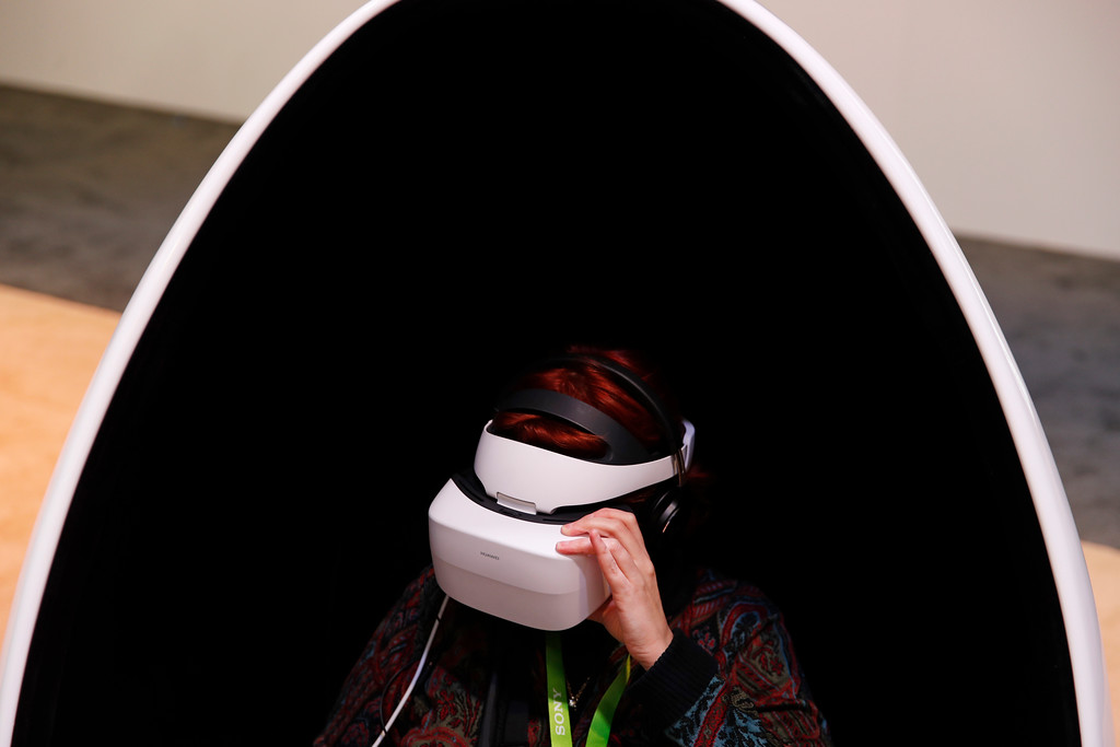. A woman wears Huawei VR2 goggles at the Huawei booth during CES International, Tuesday, Jan. 9, 2018, in Las Vegas. (AP Photo/John Locher)