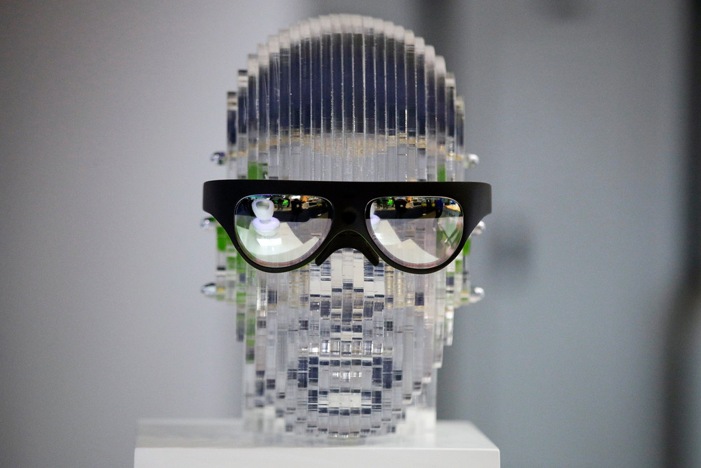 . Rokid\'s AR glasses are on display at CES International, Wednesday, Jan. 10, 2018, in Las Vegas. (AP Photo/Jae C. Hong)