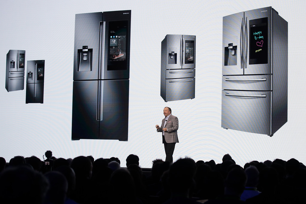 . Samsung\'s Joseph Stinziano talks about the new Family Hub smart refrigerators during a news conference at CES International, Monday, Jan. 8, 2018, in Las Vegas. (AP Photo/Jae C. Hong)