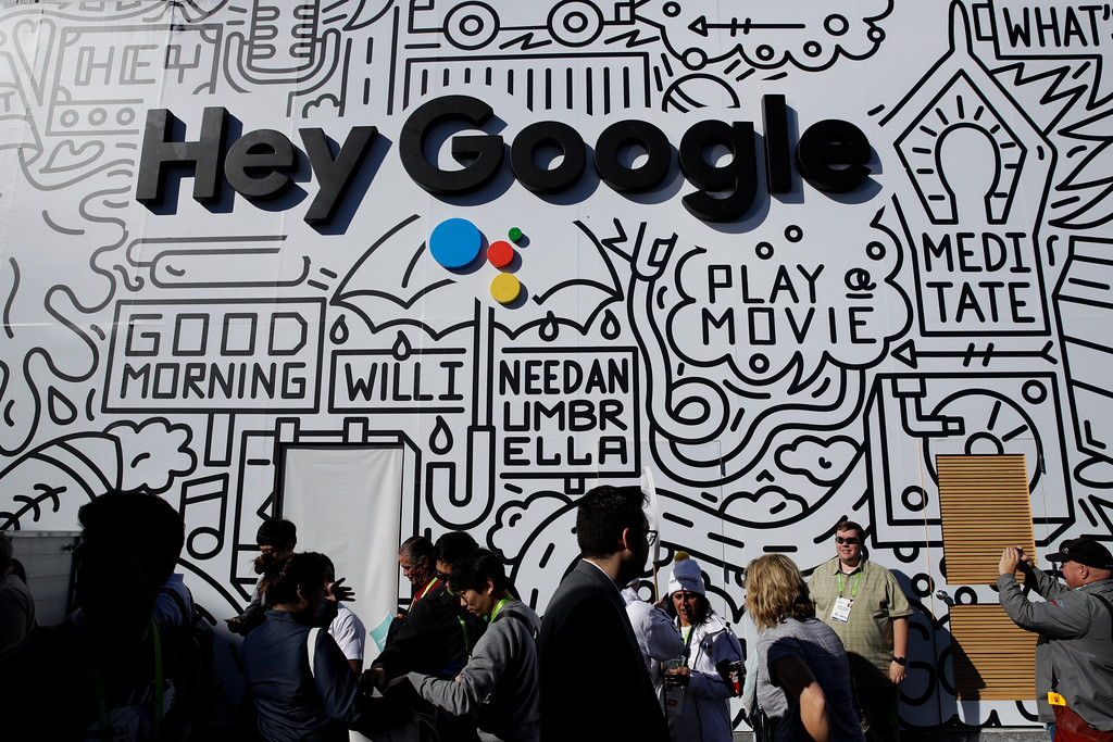 . People wait in line to enter the Google booth at CES International, Wednesday, Jan. 10, 2018, in Las Vegas. (AP Photo/Jae C. Hong)