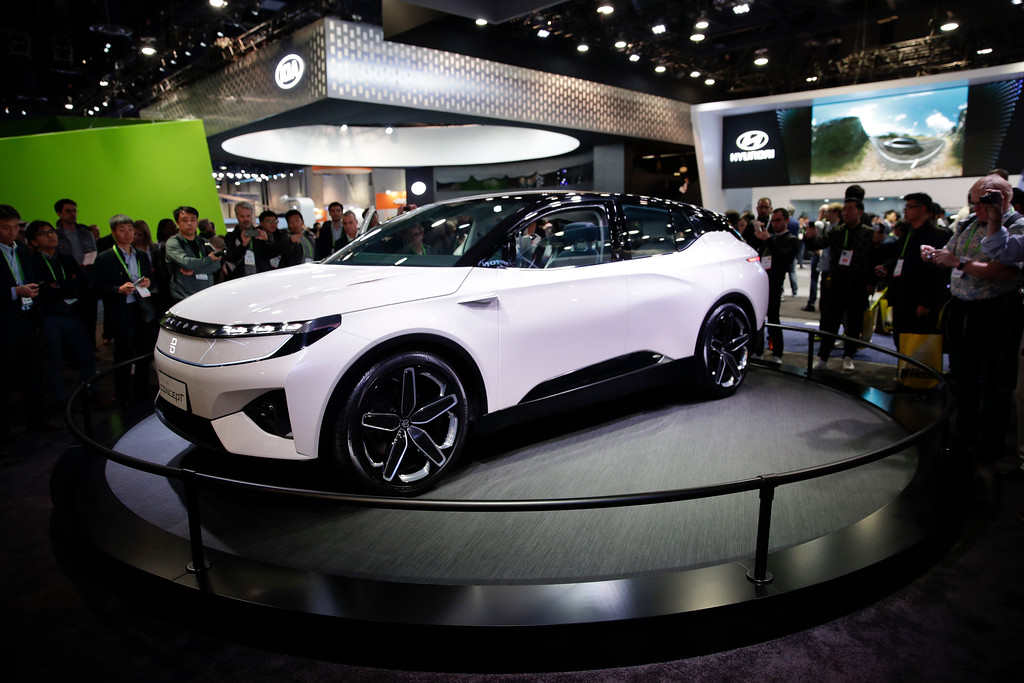 . People look at the Byton Concept at CES International, Tuesday, Jan. 9, 2018, in Las Vegas. (AP Photo/Jae C. Hong)