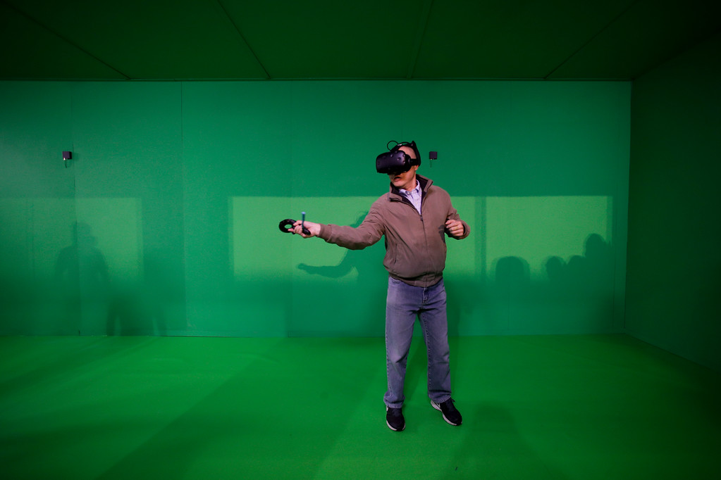 . An attendee plays a video game using the HTC Vive with DisplayLink XR\'s wireless receiver and transmitter at CES International Tuesday, Jan. 9, 2018, in Las Vegas. (AP Photo/Jae C. Hong)
