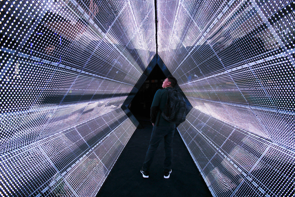 . A man stands in the 5G tunnel at the Intel booth at CES International, Tuesday, Jan. 9, 2018, in Las Vegas. (AP Photo/Jae C. Hong)