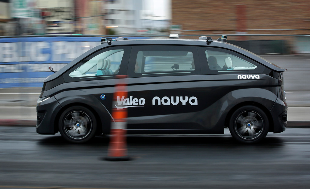 . A Navya Autonom Cab, a self-driving vehicle, drives down a street during a demonstration at CES International, Monday, Jan. 8, 2018, in Las Vegas. (AP Photo/John Locher)