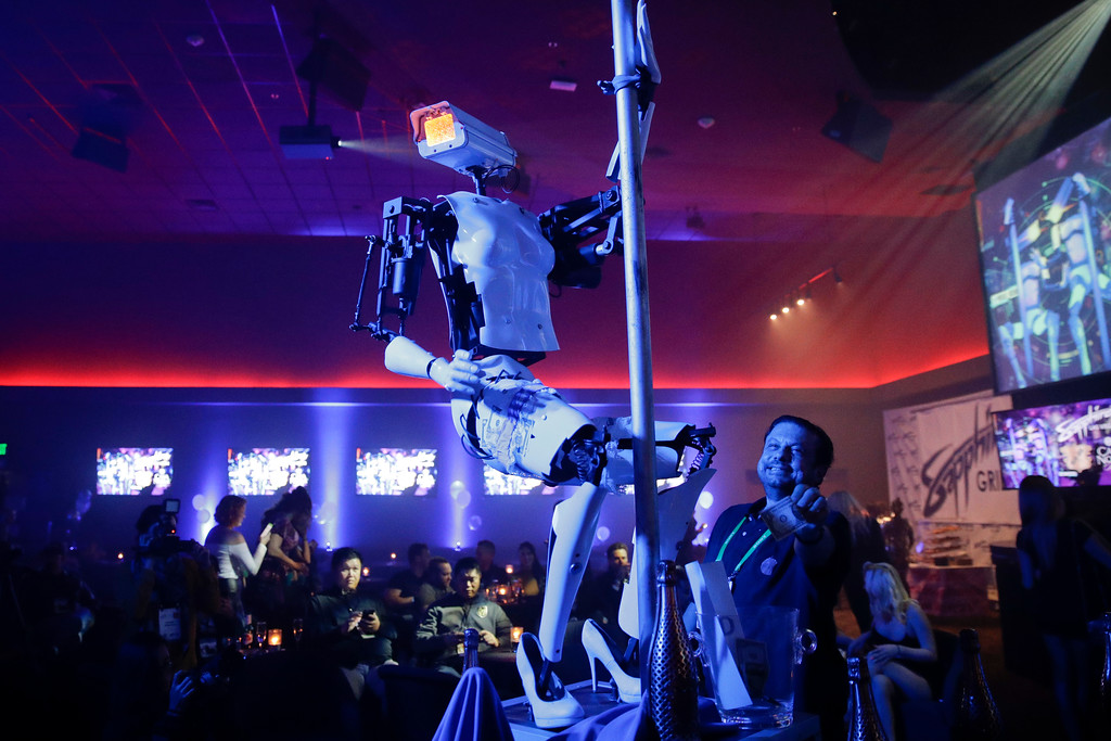 . A pole-dancing robot built by British artist Giles Walker performs at a gentlemen\'s club Monday, Jan. 8, 2018, in Las Vegas. The event was held to coincide with CES International. (AP Photo/Jae C. Hong)
