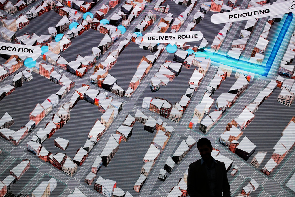 . A man is silhouetted against a digital display showing the delivery route of Ford\'s self-driving delivery vehicle at CES International, Tuesday, Jan. 9, 2018, in Las Vegas. (AP Photo/Jae C. Hong)